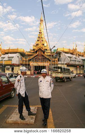 Yangon Myanmar - 9 January 2010: Policeman in front of the Sule Paya Pagoda in Yangon on Myanmar