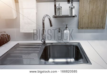 Modern clean kitchen at home with kitchenware