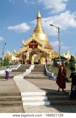 Yangon Myanmar - 9 January 2010: People walking in the area of the Maha Wizaya Paya Pagoda in Yangon on Myanmar