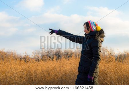 Woman In Black Pointing Her Finger Towards Blank Space