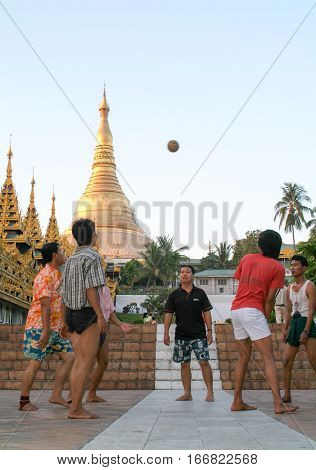 Yangon Myanmar - 9 January 2010: People playing with a ball in the area of the Shwedagon Pagoda in Yangon on Myanmar