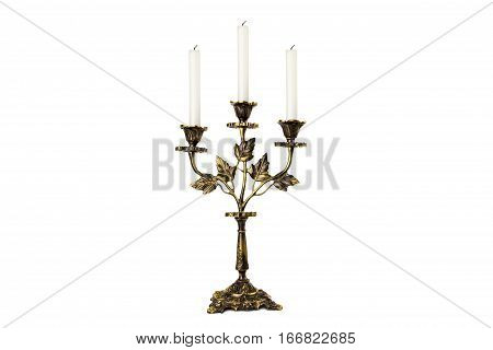 antiquarian candlestick with candles isolated on white background.