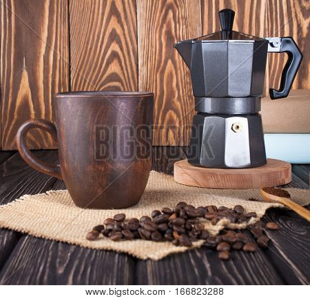 Coffee and coffee maker on wood table. Food background