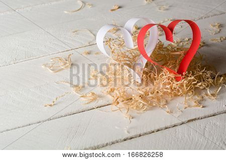 Postcard To Valentine's Day. White And Red Heart Made Of Paper Strips. Decorative Curly Wood Shaving