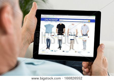 Close-up Of Person Buying Cloth While Shopping Online On Mobilephone