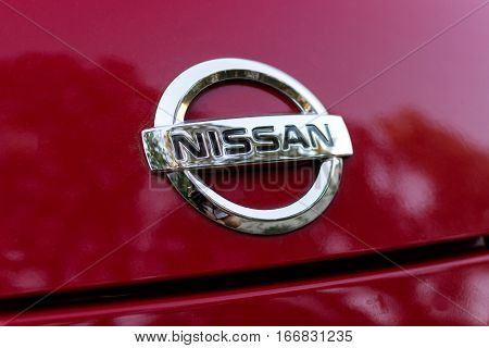 DNIPRO, UKRAINE - AUGUST 10 2013: NISSAN CAR LOGOTYPE CLOSE