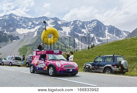 Col du Lautaret France - July 19 2014: Belin Vehicle during the passing of the advertising caravan on mountain pass Lautaret during the stage 14 of Le Tour de France 2014.