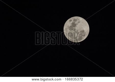 Blur moon with isolated black sky background for text adding
