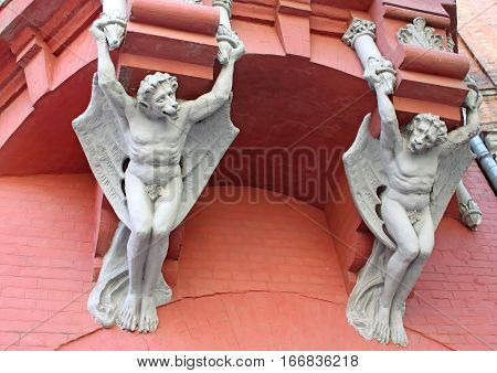 Architecture demon with wings on wall of house in Kyiv, Ukraine