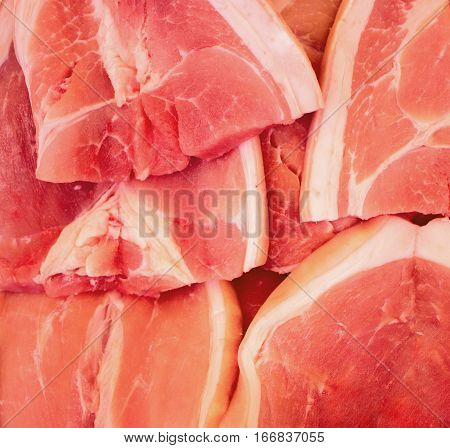 Red meat closeup photo. Tasty fresh meat sliced on supermarket display. Protein nutrition or cooking ingredient. Beef or pork red meat. Raw meat with white fat for recipe illustration or banner