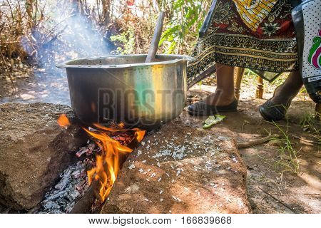 African Woman Cooks Lunch On Fire