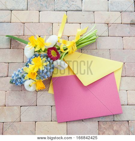 little bouquet of spring flowers on rustic stone background