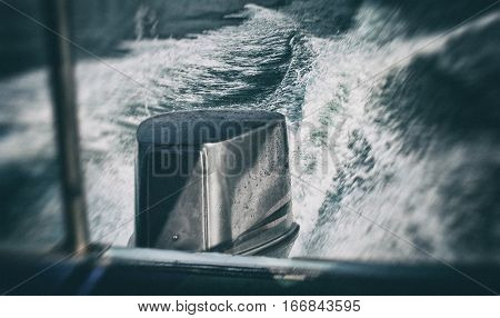 Motor boat view from the side of the boat. Styled as a movie. The appearance of movement. The trace of the motor in the water.