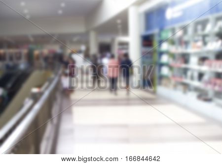 Supermarket abstract blur background. Shopping mall defocused photo for banner template or backdrop. Sale season blurry image. Shopping displays and shoppers in blur. Modern department store in blur