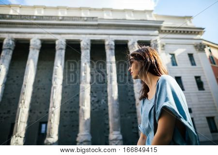 Young beautiful tourist relax in front of the Pantheon in Rome