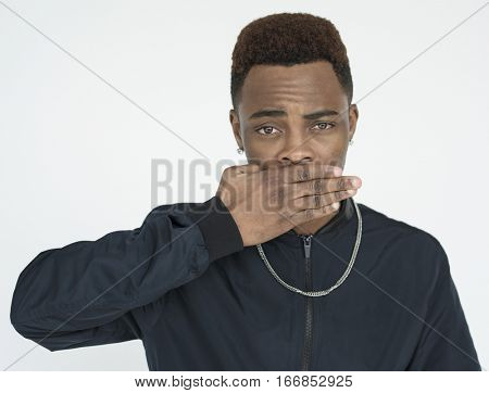 Black guy covering his mouth with hand