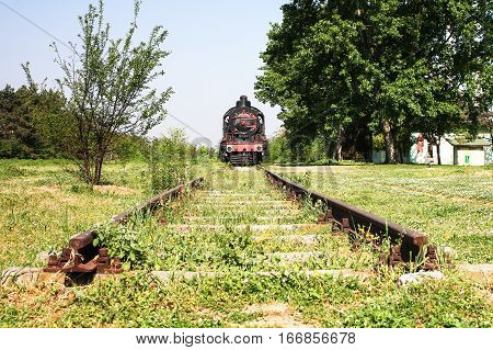 Dead end Railroad tracks at grass area