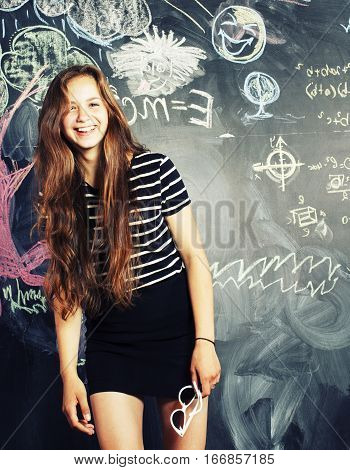 back to school after summer vacations, cute teen real girl in classroom