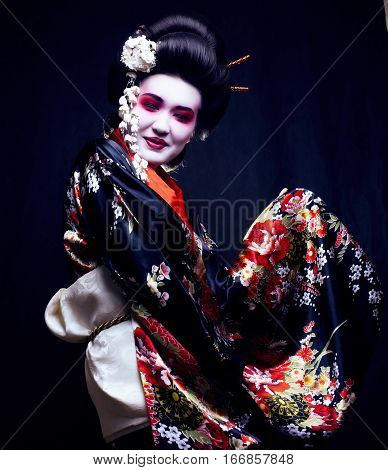 young pretty geisha in kimono with sakura and decoration, oriental look