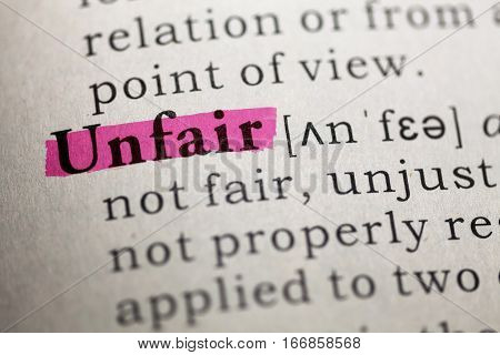 Dictionary definition of the word unfair. close up