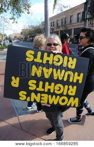 SANTA ANA, CALIFORNIA - JANUARY 21, 2017: People from Orange County carry signs, and wear t-shirts with slogans marched in Santa Ana today for the Orange County Women's March.