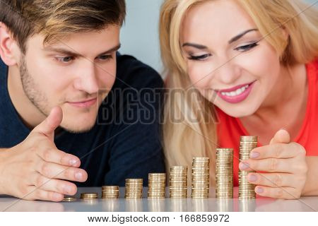 Close-up Of Young Couple Protecting And Managing Family Money Savings
