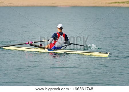 Sport rowing single scull on lake , toned image