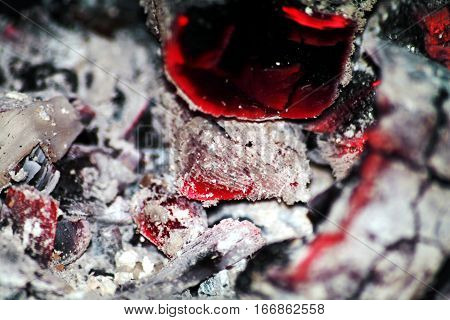 embers in the stove after burning birch wood