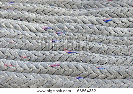 Pile of sailing ship ropes useful as background.