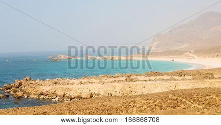 In Oman Arabic Sea  The  Hill Near Sandy Beach Sky And Mountain
