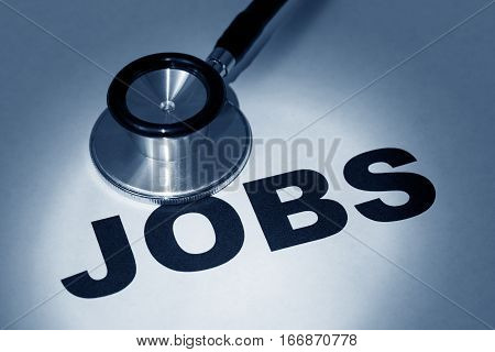 stethoscope and word job concept of employment issue.