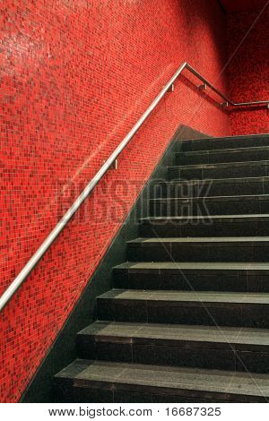 black stair with red wall