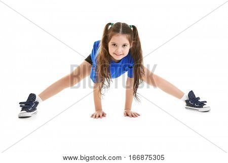 Cute little sportive girl posing on white background