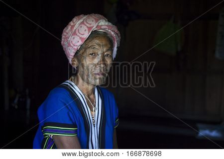 Chin region Myanmar November 11 2014: muun tribe chin lady in her kitchen