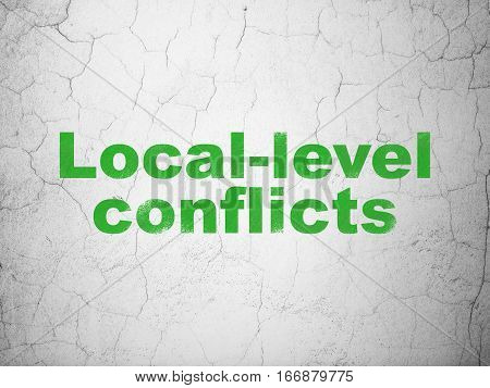 Politics concept: Green Local-level Conflicts on textured concrete wall background