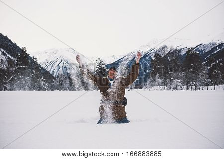 Positive Man Playing With Snow.
