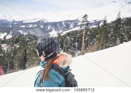 Happy girl on ski resort. Snowboarder on vacation. Lifestyle Concept Adventure winter physical activities.