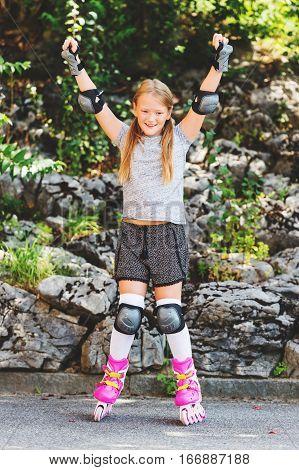 Cute girl in roller skates in the park