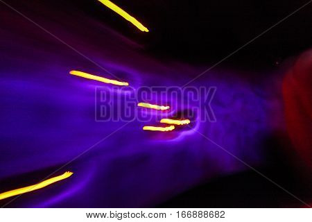 Abstract colors and light trails purple and yellow