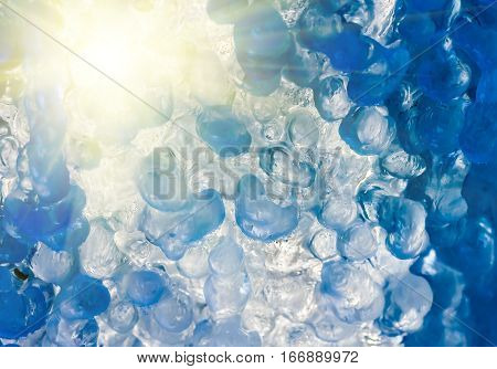 beautiful blue ice at frozen waterfall closeup winter background