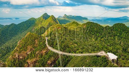 Panoramic view of Sky Bridge and Cable Car with mountains sea and tropical forests in the background Langkawi island, Malaysia. Langkawi SkyCab is one of the major attractions in the island
