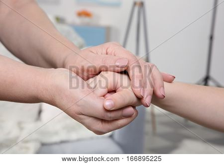 Hands of grandmother and her grandchild