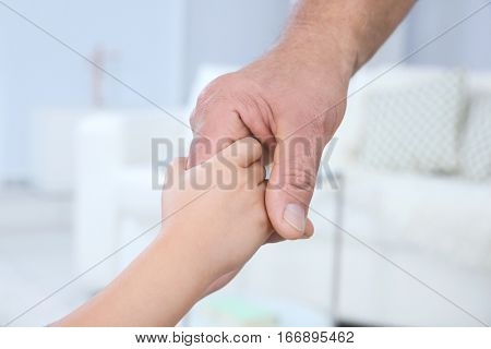 Hands of grandfather and his grandchild