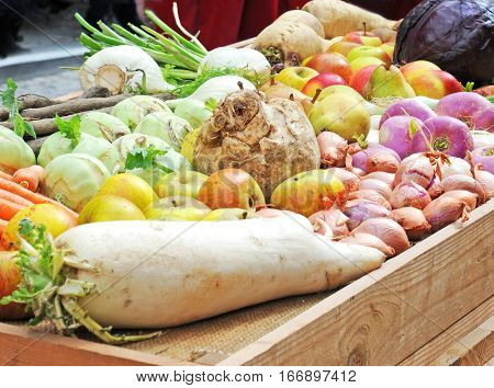 Traditional winter fruit and vegetables on wooden tray