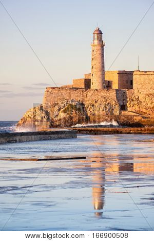 El morro fortress and lighthouse at sunset , a symbol of the city of Havana
