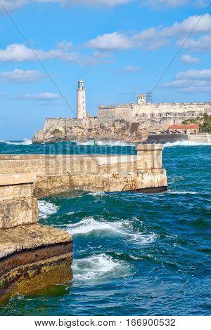The fortress and lighthouse of El Morro with a stormy sea, a symbol of the city of Havana in Cuba