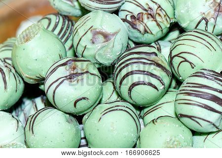 Pistachio balls with chocolate on sale in street market