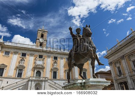 Capitol Hill in Rome with emperor Marcus Aurelius ancient roman equestrian statue and beautiful sky