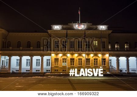 Presidential Palace in Vilnius. Night view of the Presidential Palace in Vilnius with christmas illumination, Lithuania. Night view of the Presidential Palace in Vilnius with hashtag freedom.