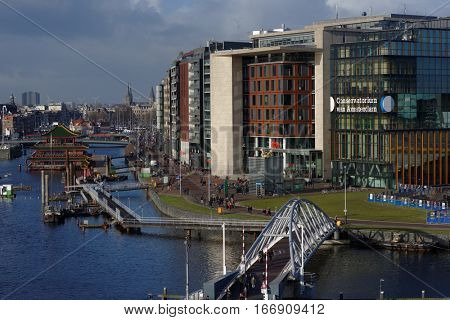 AMSTERDAM, NETHERLANDS - JANUARY 2, 2017: View to new buildings of Conservatorium and Public Library of Amsterdam. New buildings was erected in 2007-2008 next to Amsterdam Central Station
